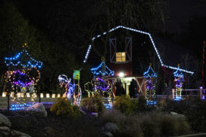 holiday lights in front of the red barn